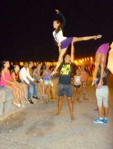 Kids from the Santiago Ballet Company celebrating on Havana's Malecon at midnight, after winning the 2015 dance competition. Photo by Barbara Wein, a member of our group.